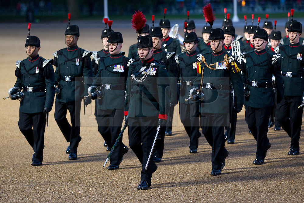 © Licensed to London News Pictures. 12/06/2013. London, UK. The Bands and Bugles of The Rifles are seen marching as musicians of the Household Division perform during the annual Beating Retreat parade at Horse Guards Parade in London. On two successive evenings each year in June a pageant of military music, precision marching and colour takes place on Horse Guards Parade in the heart of London when the Massed Bands of the Household Division carry out the Ceremony of Beating Retreat. 300 musicians, drummers and pipers perform this age-old ceremony. The Retreat has origins in the early days of chivalry when beating or sounding retreat pulled a halt to the days fighting. Photo credit: Matt Cetti-Roberts/LNP