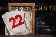 The number twenty-two beneath the Italian word Benvenuti (welcome), are seen in a window of a Shoreditch cafe, on 4th November 2019, in London, England.