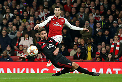 Henrikh Mkhitaryan of Arsenal crosses the ball past Fabio Borini of AC Milan - Mandatory by-line: Robbie Stephenson/JMP - 15/03/2018 - FOOTBALL - Emirates Stadium - London, England - Arsenal v AC Milan - UEFA Europa League Round of 16, Second leg