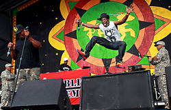 25 April 2014. New Orleans, Louisiana.<br /> Flavor Flav (white shirt) and Chuck D of Public Enemy play the New Orleans Jazz and Heritage Festival.  <br /> Photo; Charlie Varley/varleypix.com