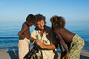 Pete Oxford and children on the beach.<br /> Mangily, near Ifaty.  South-western MADAGASCAR