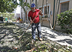 North Beach resident Jose Manuel Perez cleans debris outside his apartment in the Hurricane Irma aftermath on Tuesday, September 12, 2017, in Miami Beach. Photo by David Santiago/El Nuevo Herald/TNS/ABACAPRESS.COM