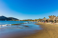 San Juan del Sur , Nicaragua - March 04 , 2018 :tourists and restaurants on the beach  in Rivas