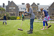 Playing croquet in the garden at Pickwell Manor. From left to right: Milly-grace (8), Zac Baker (11), Molly Elliott (10), Liza Baker (9). Pickwell Manor, Georgeham, North Devon, UK.<br /> CREDIT: Vanessa Berberian for The Wall Street Journal<br /> HOUSESHARE