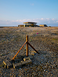Remnant fence post keeps people away from the Pagoda building of the Atomic Weapons  Research Establishment at Orford Ness in Suffolk