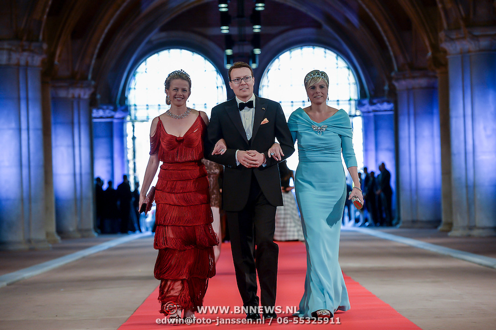 Princess Mabel, left, Prince Constantijn, center and Princess Laurentien, right, arrive for a dinner, at the invitation of Queen Beatrix, with members of the royal family and guests at the Rijksmuseum in Amsterdam, The Netherlands,on Monday night, April 29, 2013. HANDOUT/ROBIN UTRECHT