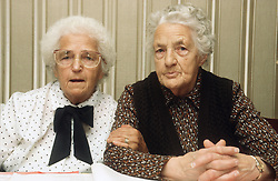 Portrait of two elderly women sitting together talking,