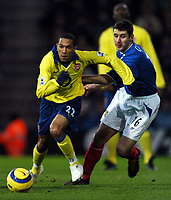 Photo: Javier Garcia/Back Page Images<br />Portsmouth v Arsenal, FA Barclays Premiership, Fratton Park, 19/12/04<br />Gael Clichy slips away from Andy Griffin