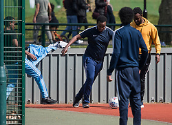 © Licensed to London News Pictures. 04/04/2020. London, UK. A group of young men playing a game of football at Paddington Recreation Ground in London, during a pandemic outbreak of the Coronavirus COVID-19 disease. The public have been told they can only leave their homes when absolutely essential, in an attempt to fight the spread of coronavirus COVID-19 disease. Photo credit: Ben Cawthra/LNP