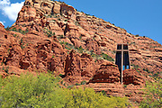 The Chapel built in the Arizona desert<br /> <br /> Jutting out of the red sandstone walls in the Arizona desert, the Chapel of the Holy Cross near the town of Sedona, is a marvel of modern architecture. The Roman Catholic chapel was designed by a student of Frank Lloyd Wright, sculptor Marguerite Brunswig Staude, who drew inspiration for its design from the newly constructed Empire State Building in New York. The chapel is directly over a butte, nearly 200 feet above the valley. The interior is very simple, with nothing more than a few pews and an alter. No traditional services are held within the chapel, as it is meant to be a place of reflection and meditation.<br /> The chapel is located on the lands of Coconino National Forest, and required a special-use permit to have it built. It was completed in 1956. The chapel belongs to the Parish of Saint John Vianney and the Roman Catholic Diocese of Pheonix.<br /> ©Exclusivepix Media