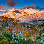 An autumn weather system breaks up at sunset over the valley on McClure Pass near Carbondale. Colorado.