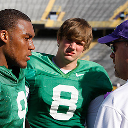 April 9, 2011; Baton Rouge, LA, USA; LSU Tigers quarterbacks (left to right)LSU Tigers quarterback Jordan Jefferson, Zach Mettenberger,talk with offensive coordinator Steve Kragthorpe during the 2011 Spring Game at Tiger Stadium.   Mandatory Credit: Derick E. Hingle