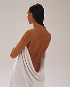 Woman holding towel around her body after a bath