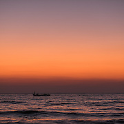 A fishing boat goes out to see after sunset on on Agonda beach in teh western state of Goa. A traditional fishing village, Agonda has maintained a simplicity and charm that have earned it a reputation of one of the top beach destinations in Asia.