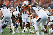 AUSTIN, TX - SEPTEMBER 19:  Jerrod Heard #13 of the Texas Longhorns calls a play at the line of scrimmage against the California Golden Bears on September 19, 2015 at Darrell K Royal-Texas Memorial Stadium in Austin, Texas.  (Photo by Cooper Neill/Getty Images) *** Local Caption *** Jerrod Heard