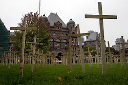 October 1, 2018 - Toronto, ON, Canada - TORONTO, ON - OCTOBER 1  - The Toronto Overdose Prevention Society placed over 1,200 wooden crosses on the front lawn of Queen's Park, October 1, 2018. Andrew Francis Wallace/Toronto Star (Credit Image: © Andrew Francis Wallace/The Toronto Star via ZUMA Wire)