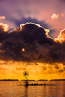 Palm trees on a small island at sunset, Four Seasons Resort Bora Bora, Motu Tehotu, Bora Bora, French Polynesia