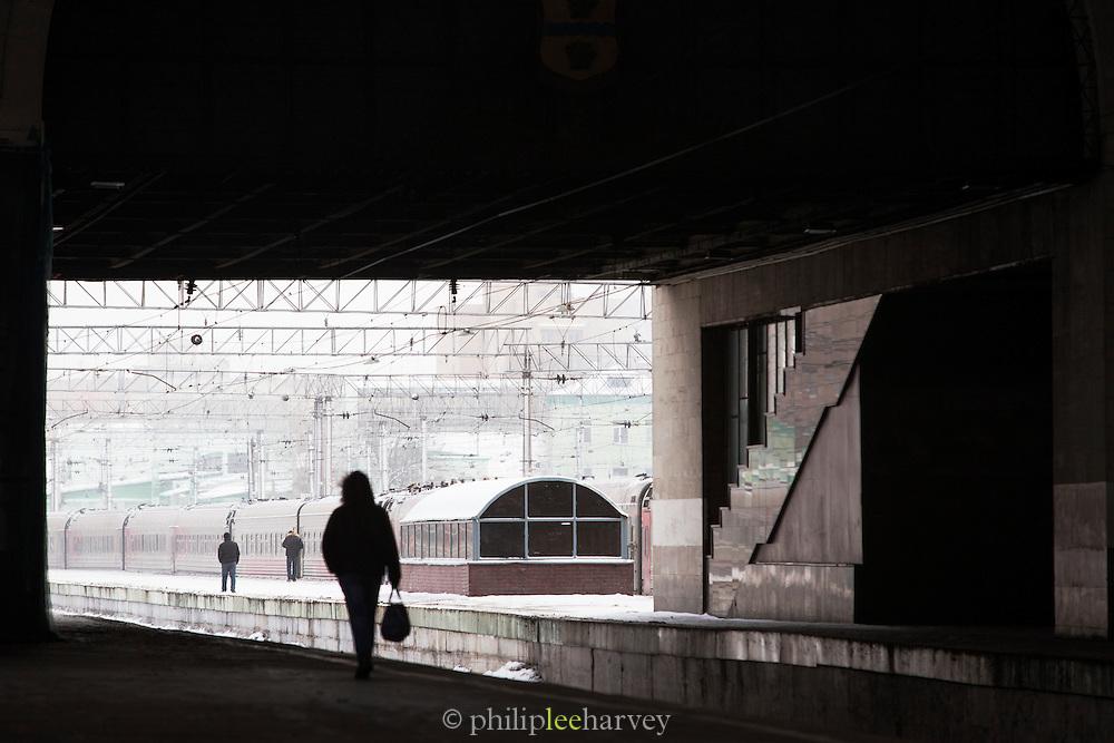 Passenger walking along platform at Yaroslavsky railway station, Moscow. Russia