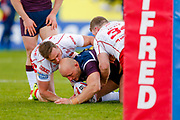 Leeds Rhinos loose forward Carl Ablett (12) is stopped  during the Betfred Super League match between Hull Kingston Rovers and Leeds Rhinos at the Lightstream Stadium, Hull, United Kingdom on 29 April 2018. Picture by Simon Davies.