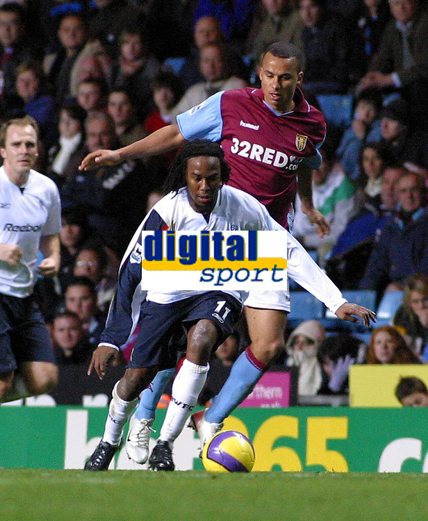 Photo: Dave Linney.<br />Aston Villa v Bolton Wanderers. The Barclays Premiership. 16/12/2006. Bolton's  Ricardo Gardner(L) tries to find a way through the Villa defence.