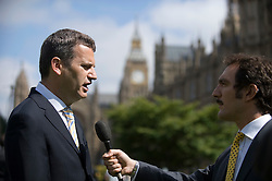 © licensed to London News Pictures. 19/07/2011. London, UK.  Mark Lewis, Solicitor to the Dowler family talking to news television crews on College Green outside the Houses of Parliament  today (19/07/2011) before Rebekah Brooks and Rupert Murdoch give evidence to the Culture, Media and Sport Committee in relation to the News Of The World phone hacking scandal. Photo credit should read Ben Cawthra/LNP