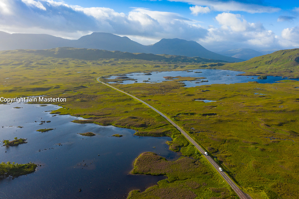 Aerial view of A82 road crossing Rannoch Moor with Loch Ba on left, in summer, Scotland, UK