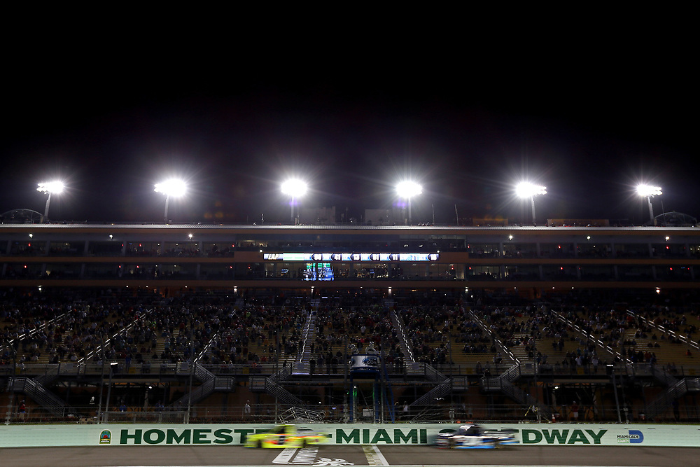 Nov 18, 2016; Homestead, FL, USA; The field crosses the start/finish line during the Ford Ecoboost 200 at Homestead-Miami Speedway. Mandatory Credit: Peter Casey-USA TODAY Sports