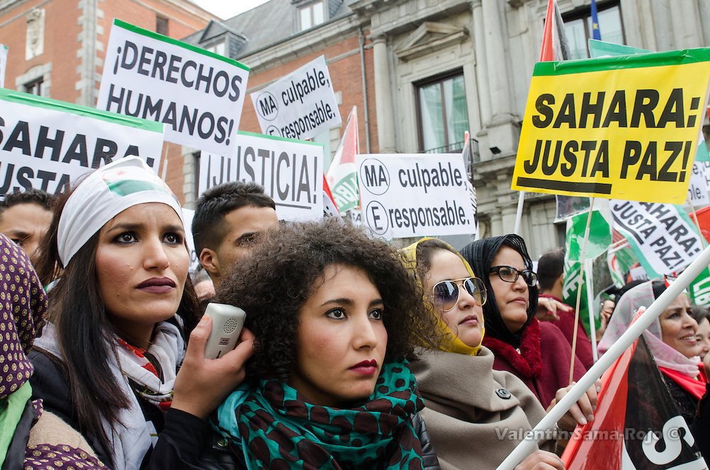 Madrid, Spain. 12th November, 2016. Women listening to Saharawi representatives at the end of the demonstration for a free Sahara.