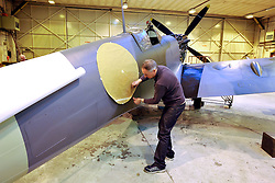 "© Licensed to London News Pictures. File picture dated 13/12/2012. Bristol, UK. Steve Atkin of Warbird Colour repainting a Mark IX Spitfire fighter. Engineers race to finish work rebuilding a Mark IX Spitfire fighter circa 1943, at Filton airfield near Bristol. The plane has been rebuilt  by John Hart engineering, it is the last plane to be completed at the airfield and was flown out on 18 December 2012 by pilot Bill Perrins. Filton, the birthplace of the British-built Concorde jets, is to close on Friday (21st December 2012). Its owner BAE Systems says it is not viable and intends to sell it for housing and business development. BAE Systems said the airfield was closing following a comprehensive assessment over a five-year period and an independent review, ""both of which concluded that the airfield was not economically viable"".  Airbus has said it is fully committed to the Filton site, where it has a base making aircraft wings.  A spokesman said: ""The closure of the airfield will have no significant effect on our business and we have mitigation plans in place regarding the change of venue for our passenger shuttle (using Bristol airport) and the transportation of the A400M wings (via Portbury docks).  Planes currently based at Filton will have to find new homes. The airfield officially closes for flights this Friday, though the police helicopter will still be based there. BAE is supporting a new museum at Filton to ""house Concorde Alpha-Foxtrot and Bristol's aviation heritage."".Photo credit : Simon Chapman/LNP"