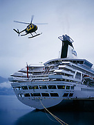 Soloy Helicopter Hughes 500 flying past stern of the cruise ship Royal Princess, Valdez, Alaska.
