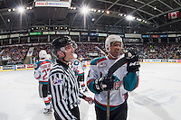 KELOWNA, CANADA - JANUARY 27: Linesman Tim Plamondon shares a laugh at the bench with Devante Stephens #21 of the Kelowna Rockets against the Kamloops Blazers on January 27, 2017 at Prospera Place in Kelowna, British Columbia, Canada.  (Photo by Marissa Baecker/Shoot the Breeze)  *** Local Caption ***