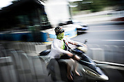 "A Chinese woman drives her electric motor-scooter wearing a scarf to protect from air pollution in the traffic jam of Beijing, China, July 20, 2014.<br />   <br /> This picture is part of the series ""Urban Chinese Streets"", a journey on the streets of Chinese cities to discover their modern citizens and habits.    <br /> <br /> © Giorgio Perottino"