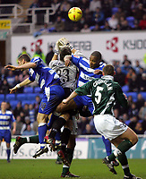 Fotball<br /> England 2004/2005<br /> Foto: SBI/Digitalsport<br /> NORWAY ONLY<br /> <br /> Reading V Plymouth Argyle<br /> The Coca_Cola Championship.<br /> Madejski Stadium<br /> 05/02/2005<br /> <br /> Plymouth's goalie Luke McCormick and Graham Coughlan hold Reading's Nicky Forster and Les Ferdinand off from scoring a goal.