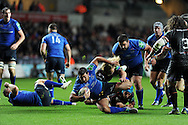 Leinster's Rob Kearney © is tackled by Richard Hibbard of the Ospreys. Heineken cup rugby, pool 1 match, Ospreys v Leinster rugby at the Liberty stadium in Swansea on Sat 12th October 2013 pic by Andrew Orchard, Andrew Orchard sports photography,