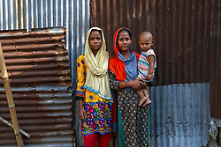 May 5, 2019 - Dhaka, Bangladesh - Cousins SAFIA KHATUN (13) and RABEYA AKTER (16), with her 18-month old baby, pose for a photograph in a slum area. Safia is newly married and Rabeya was married when she was just 13. According to Human Rights Watch, Bangladesh has one of the highest rates of child marriage in the world, with 2 percent of girls marrying before the age of 15, and 65 percent before they turn 18. (Credit Image: © Kazi Salahuddin/ZUMA Wire)