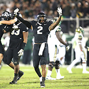 UCF Knights linebacker Chequan Burkett (2) celebrates a play during a NCAA football game between the University of South Florida Bulls and the UCF Knights at Spectrum Stadium on Friday, November 24, 2017 in Orlando, Florida. (Alex Menendez via AP)
