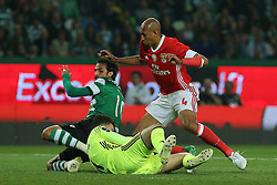 April 22, 2017 - Lisbon, Lisbon, Portugal - Benficas defender Luisao from Brazil (R) and Sportings forward Bryan Ruiz from Costa Rica (L) with Benficas goalkeeper Ederson Moraes from Brazil  (C) during Premier League 2016/17 match between Sporting CP and SL Benfica, at Alvalade Stadium in Lisbon on April 22, 2017. (Credit Image: © Dpi/NurPhoto via ZUMA Press)