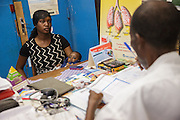A woman and her child meet with a nurse during a consultation at the Libreville health center in Man, Cote d'Ivoire on Wednesday July 24, 2013.