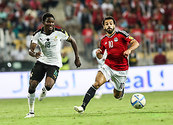 ALEXANDRIA, EGYPT - NOVEMBER 13: Mohamed Salah (R) of Egypt in action against Daniel Amartey (L) of Ghana during the 2018 World Cup Africa qualifying match between Egypt and Ghana at the Borg el-Arab Stadium in Alexandria, Egypt on November 13, 2016. Ibrahim Ramadan / Anadolu Agency    BRAA20161114_054 Alexandria Egypte Egypt