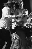 A couple dances salsa near the main square in Trinidad, Cuba