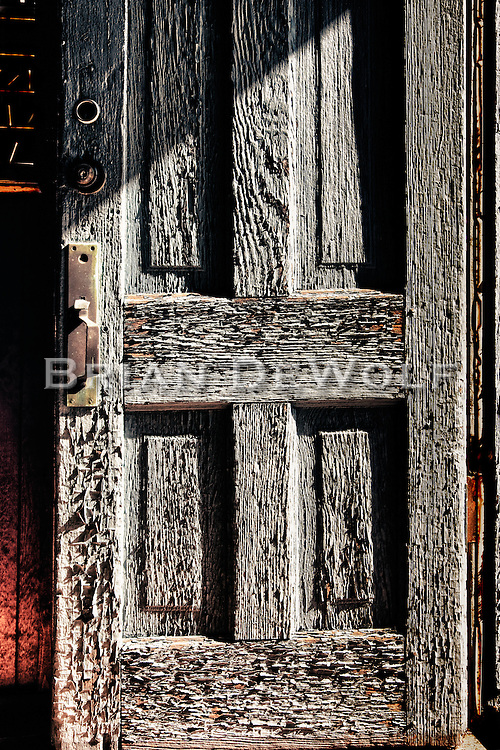Weather-beaten front door to an old general store in Kendall County Illinois.