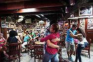 Dancing salsa in the historic bar of Plaza de los coches