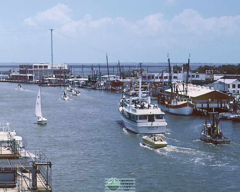 1978 Clear Creek Channel wterfronts of Kemah and Seabrook Texas with pleasure boats, seafood restaurants and fishing, shrimp and oyster boats.