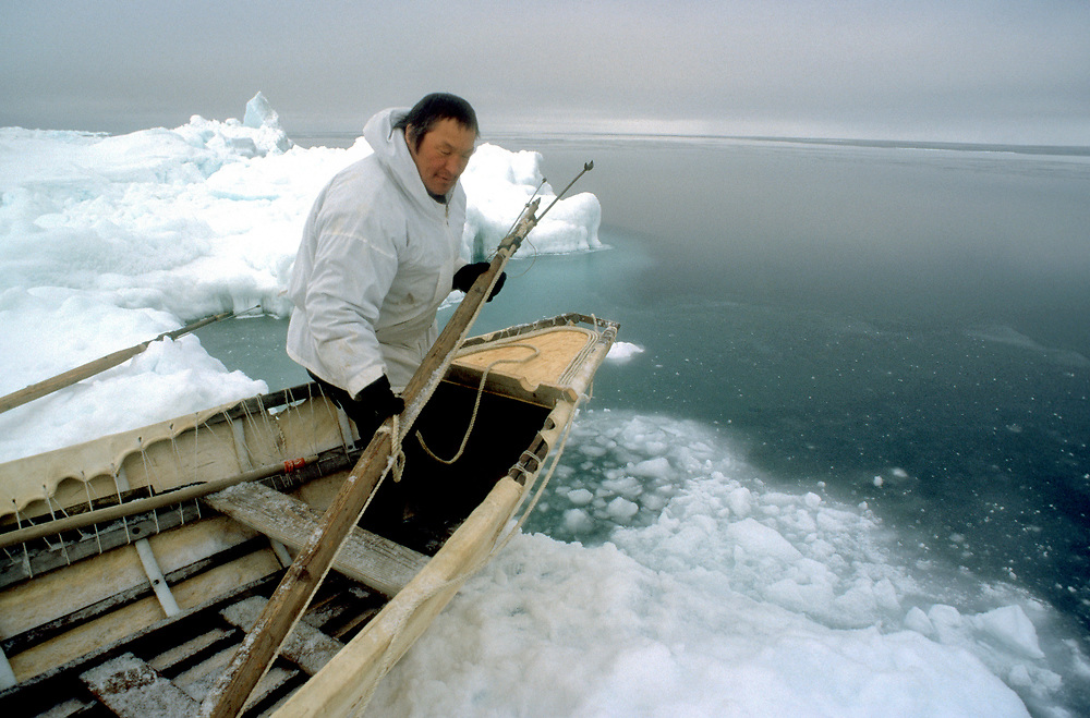 Barrow, Alaska, Alaska Native whaler prepares his umiak with harpoon and buoy for the annual bowhead whale hunt in the Chukchi Sea