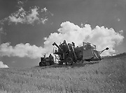 9969-7067. Combine with cloud background at the wheat ranch of John G. Godknecht near Boyd, Oregon. August 9, 1947.