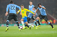 Brazil forward Neymar Jr (10) attempts to avoid the Uruguay defence during the Friendly International match between Brazil and Uruguay at the Emirates Stadium, London, England on 16 November 2018.