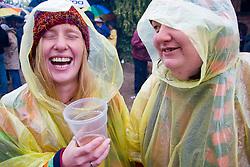 Two women enjoying themselves at the Cropredy Festival  Fairport's Cropredy Convention  2005; despite the rain,