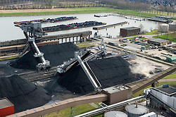 Coal is unloaded from barges at the Essent Energie power station, in Geertruidenberg, Netherlands, on Monday March 22, 2010. Essent Energie is owned by RWE AG. (Photo © Jock Fistick).