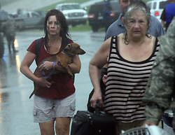 29 August 2012. Braithwaite, Plaquemines Parish, Louisiana,  USA. .Emergency evacuations. Hurricane Isaac batters the community of Braithwaite in Plaquemines Parish where residents were evacuated following the overtopping of a  levee. The water gushed in, inundating peoples houses on the 7th year anniversary of Hurricane Katrina..Photo; Charlie Varley.