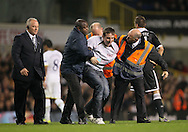A third pitch invader comes onto the pitch and is escorted off<br /> <br /> Europa League Group C- Tottenham vs Partizan Belgrade - White Hart Lane - England - 27th November 2014 - Picture David Klein/Sportimage
